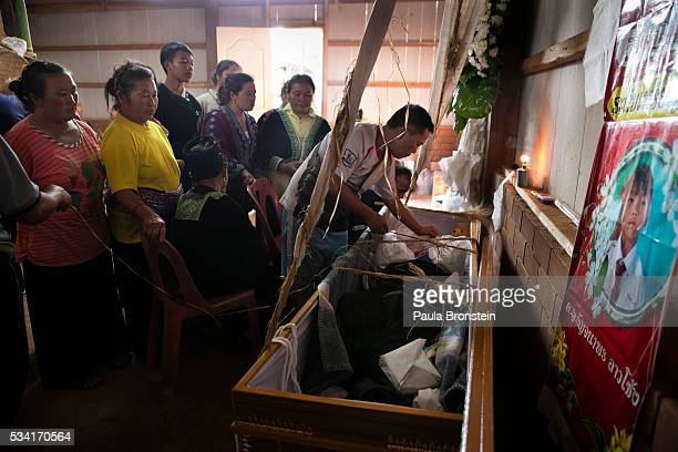 The Hmong community gathers for the funeral of Kanjanaporn Lasasong age 8 in Mae Wang Chiang Mai province May 25 2016 A tragic fire broke out on...