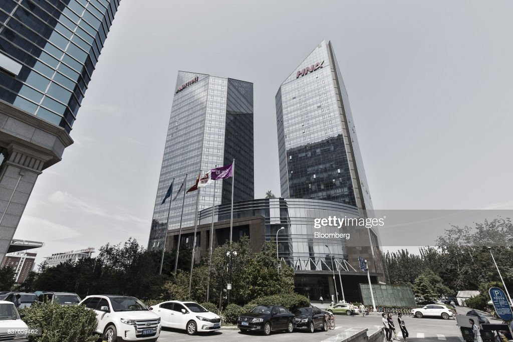 The HNA Group Co. building stands in Beijing, China, on Wednesday, Aug. 9, 2017. Big Chinese dealmakers including HNA have been under increasing scrutiny this year as the Communist Party steps up its clampdown of capital outflows to protect the yuan from weakening further. Photographer: Qilai Shen/Bloomberg via Getty Images
