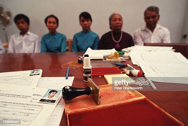 The Hoang family at an interview with American Immigration and Naturalization Service officials who will determine whether they may leave Vietnam for...