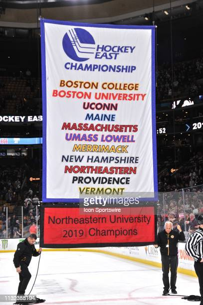 The Hockey East banner with the new Northeastern University 2019 champions banner below it. During the Hockey East Championship game featuring the...