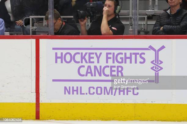 The Hockey Fights Cancer logo is seen during a regular season NHL hockey game between the Arizona Coyotes and the Detroit Red Wings on November 13 at...