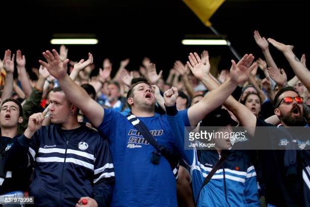 The Hoffenheim fans surport their team prior to the UEFA Champions League Qualifying PlayOffs round second leg match between Liverpool FC and 1899...