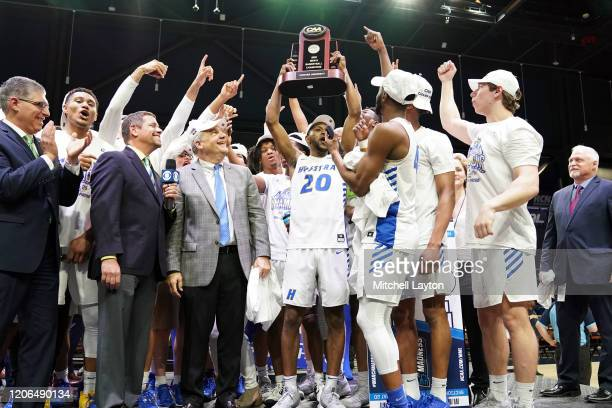 The Hofstra Pride celebrate winning the CAA Men's Basketball Tournament - Championship college basketball game against the Northeastern Huskies at...