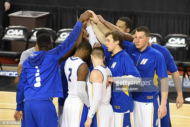 The Hofstra Pride huddle before the Colonial Athletic Conference Championship college basketball game between the North CarolinaWilmington Seahawks...