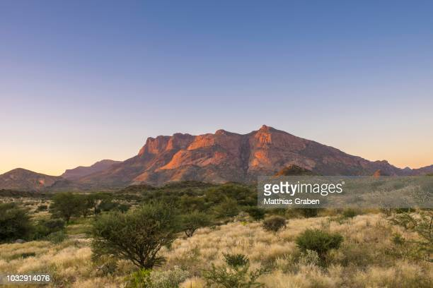 the hohenstein, summit and landscape in the evening light, erongo mountains, erongo region, namibia - erongo stock photos and pictures