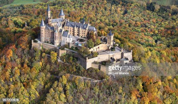 The Hohenzollern Castle is surrounded by autumnally coloured trees near Bisingen Germany 13 October 2017 Photo Thomas Warnack/dpa