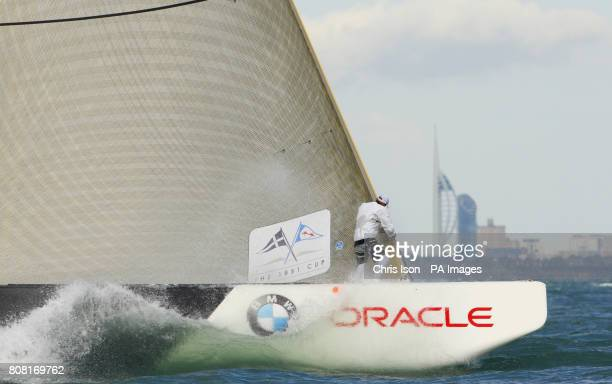 The holders of the America's Cup BMW Oracle from the USA pass the Spinnaker Tower in the distance as they race against the British team Team Origin...