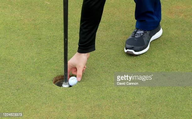 The holes on the greens with upside down 'flagstick cups' that enable the golfers to retrieve their golf balls without touching the flagsticks as...