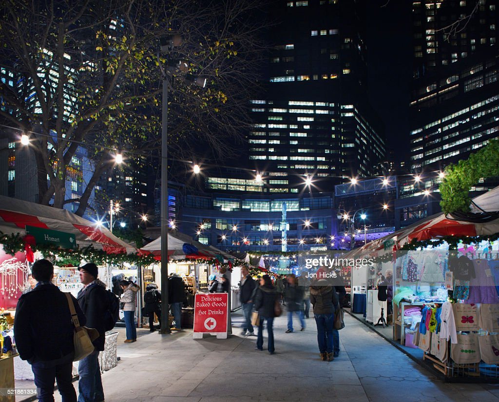 Shoppers and stalls in the Holiday Market at Colombus Circle.