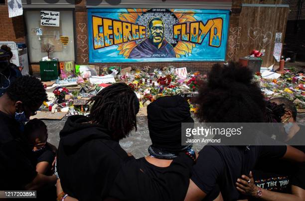 The Holloway family of Minneapolis along with other mourners fill the intersection in front Cup Foods where George Floyd was murdered by a...