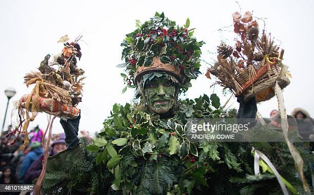 The Holly Man the winter guise of the Green Man a character from pagan myths and folklore holds the crowns of the new King and Queen during a...