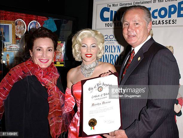 The Hollywood Museum President and Founder Donelle Dadigan Marilyn Monroe impersonator Gailyn Addis and Los Angelses City Council member Tom LaBonge...