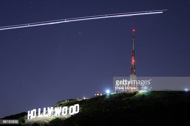 The Hollywood Sign is illuminated by the spotlight of a helicopter streaking past the sign at night on November 16 2005 in Los Angeles California The...