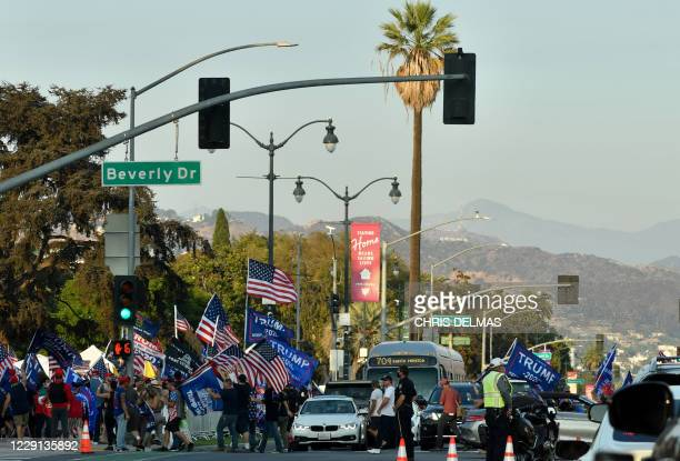 The Hollywood sign is seen in the distance as people rally in support of US President Donald Trump in Beverly Hills, California, October 17, 2020.
