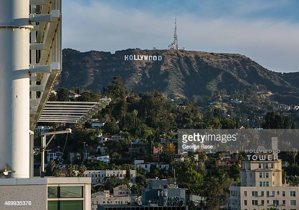 The Hollywood Sign is viewed from the W Hotel rooftop on Hollywood Boulevard on March 23 2015 in Hollywood California Millions of tourists flock to...
