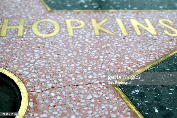 The Hollywood Walk of Fame is mysteriously buckling the black terrazzo stone surrounding the pink stars is pouching up sometimes at night Fissures...