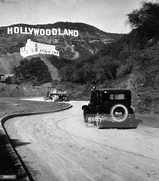 The Hollywoodland sign in Los Angeles marking the centre of America's film and television industries It was later changed to read 'Hollywood'