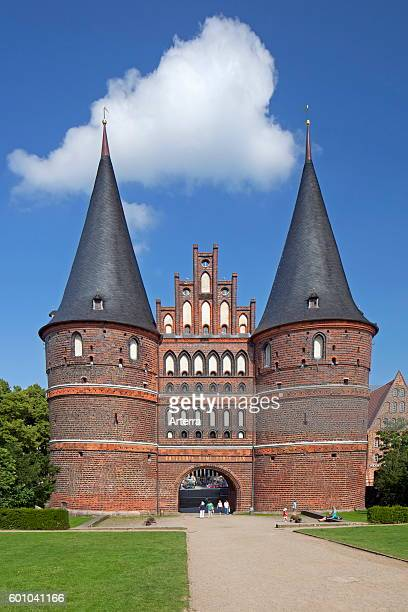 The Holsten Gate / Holstein Tor / Holstentor a Brick Gothic city gate at the Hanseatic city of Lubeck SchleswigHolstein Germany