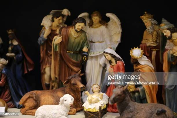 the holy family - manger stock photos and pictures