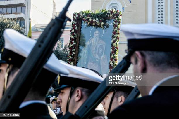 The holy icon of Saint Spyridon passes in front of the Port Police outside the Orthodox church of Saint Spyridons during the celebration of memorial...