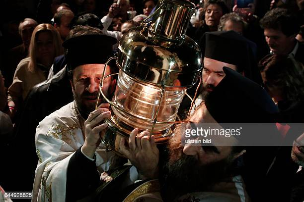 The Holy Light arrives in Athens from the Church of Resurrection in Jerusalem On Holy Saturday April 11 2015