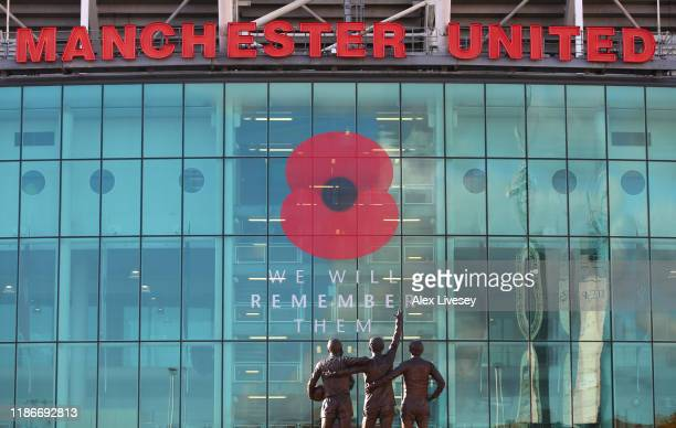 The 'Holy Trinity' statue is seen outside the stadium in front of the Poppy which is displayed as a mark of respect for Armistice Day prior to the...