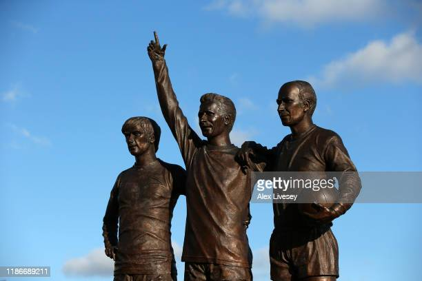 The 'Holy Trinity' statue is seen outside the stadium prior to the Premier League match between Manchester United and Brighton Hove Albion at Old...