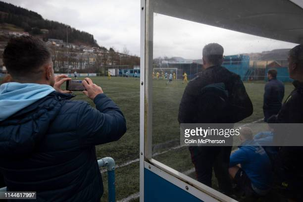 The home bench watch the action during the secondhalf as Cambrian and Clydach Vale take on Cwmbran Celtic at King George's New Field in a Welsh...