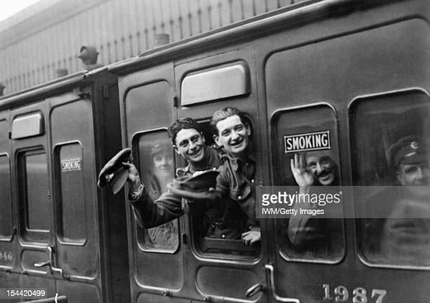 The Home Front In Britain During The First World War Soldiers smile for the camera as they wave cheerfully from the window of a leave train at...