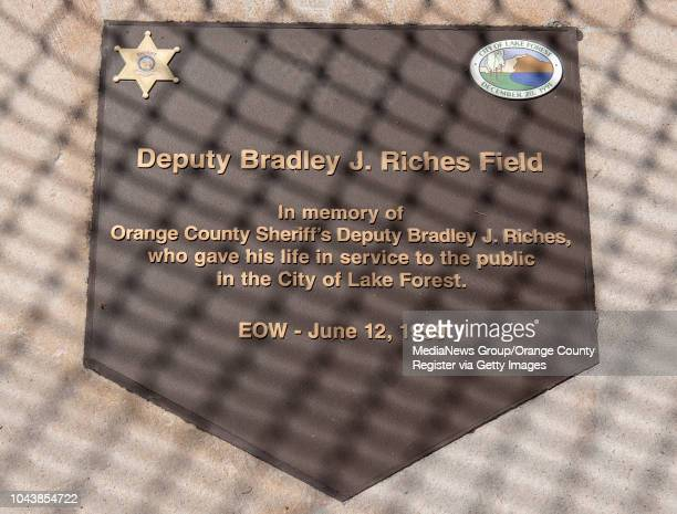 The home plateshaped plaque names a baseball field for Orange County sheriff's Deputy Bradley Riches who was killed in the line of duty on June 12...