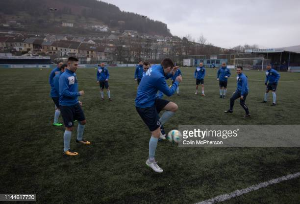 The home players taking part in their prematch warm up before Cambrian and Clydach Vale take on Cwmbran Celtic at King George's New Field in a Welsh...