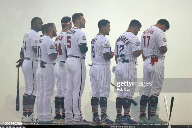 The Home Run Derby participants stand during the national anthem during the TMobile Home Run Derby at Nationals Park on July 16 2018 in Washington DC