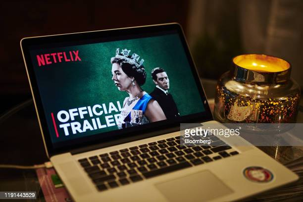 """The home screen for the Netflix Inc. Original web television series """"The Crown"""" is displayed on an Apple Inc. Laptop computer in an arranged..."""