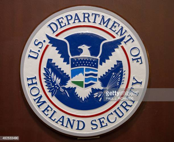 The Homeland Security seal is seen before a press conference discussing ongoing enforcement efforts to combat human smuggling along the Southwest...