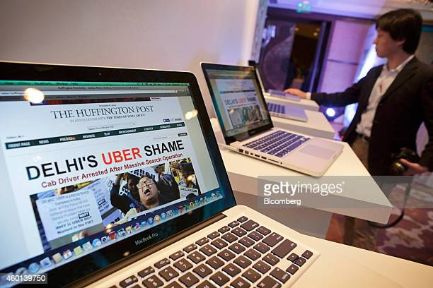 The homepage of the Huffington Post's Indian edition is displayed on Apple Inc MacBook Pro laptop computers at an AOL Huffington Post Media Group...