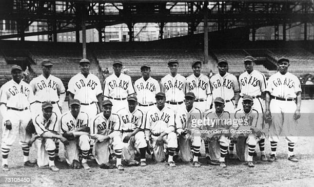 The Homestead Grays Negro League baseball club pose for a team shot in their home park Forbes Field in Pittsburgh in 1942 Hall of Fame members on the...