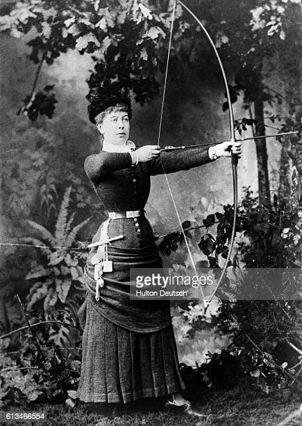 The Hon Mrs Hugh Rowley photographed holding a bow and arrow in 1875