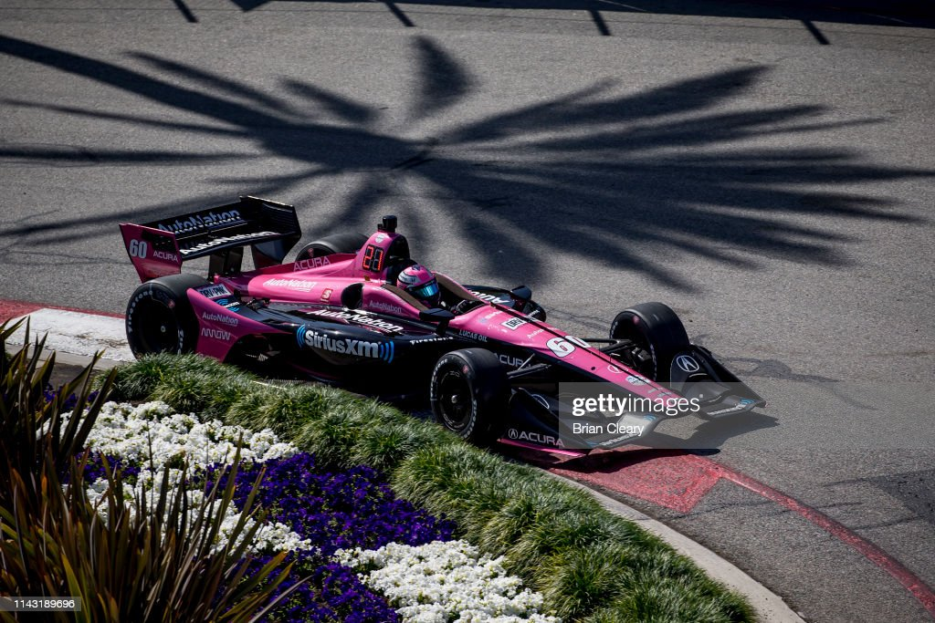 The Honda IndyCar of Jack Harvey, of Great Britain, races on the