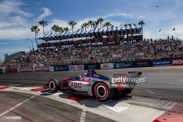 The Honda IndyCar of Tony Kanaan of Brazil races on the track during the IndyCar race at the Acura Grand Prix of Long Beach on the streets of Long...