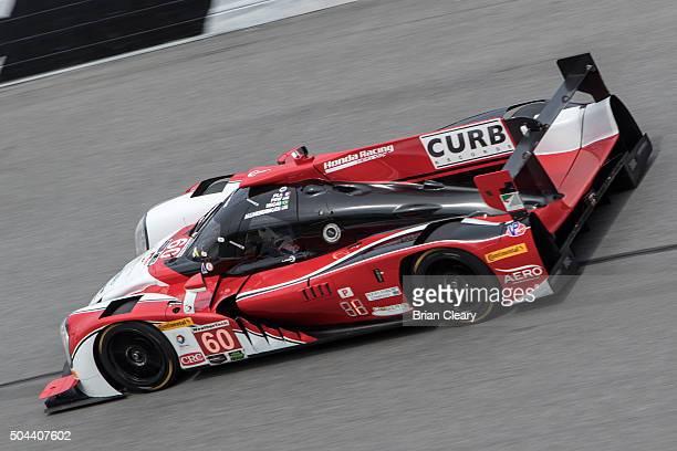 The Honda Ligier of Oswaldo Negri Jr John Pew AJ Allmendinger and Olivier Pla drives on the track during the Roar Before the 24 IMSA WeatherTech...
