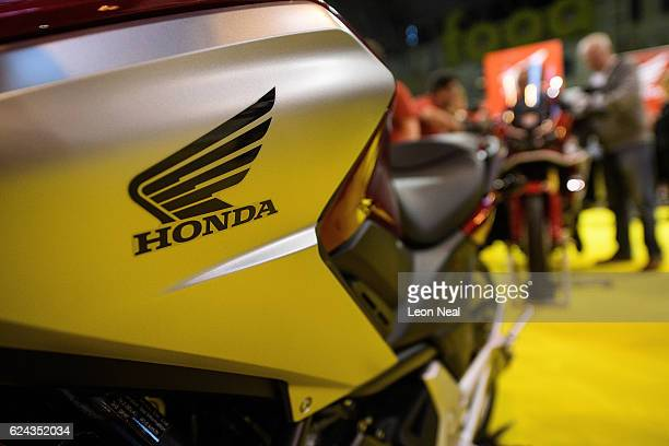 The Honda logo is seen on a motorbike at the 'Motorcycle Live' show on November 19 2016 in Birmingham England The show features the latest bikes...