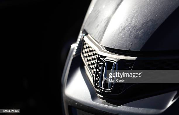 The Honda logo is seen on a worker's Honda Civic parked in the car park at the Honda car assembly plant following the announcement that the firm is...