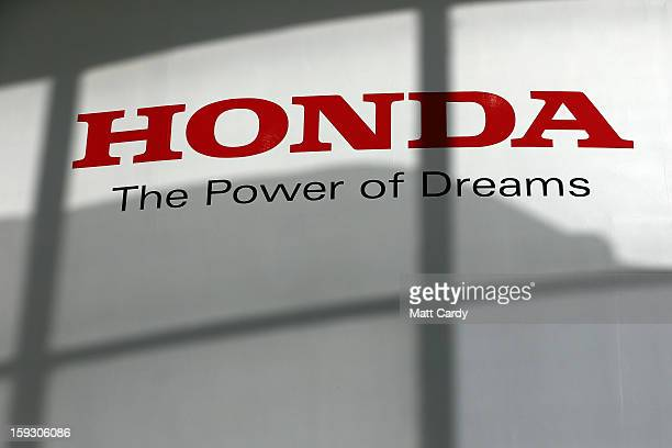 The Honda logo is seen on the wall of a building at the Honda car assembly plant following the announcement that the firm is to axe 800 jobs on...