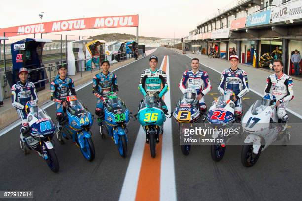 The Honda Moto3 riders pose near the bike in pit at the end of the qualifying practice during the Comunitat Valenciana Grand Prix Moto GP Previews at...