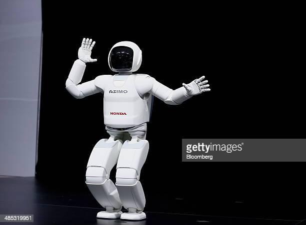The Honda Motor Co Asimo robot makes a presentation during the 2014 New York International Auto Show in New York US on Thursday April 17 2014 Honda...