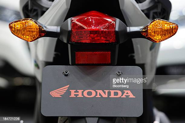 The Honda Motor Co logo is displayed on the company's NC700X motorbike equipped with DRIVE C2X technology at the ITS Word Congress Tokyo 2013 in...