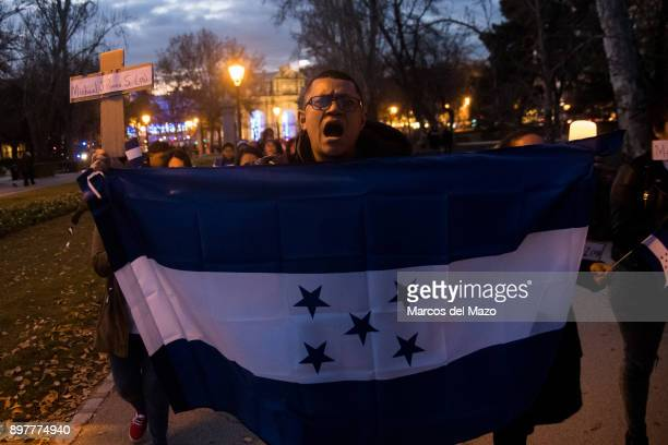 The Honduran community in Madrid marching against President elect Juan Orlando Hernandez calling for democracy and peace in Honduras. Demonstrators...