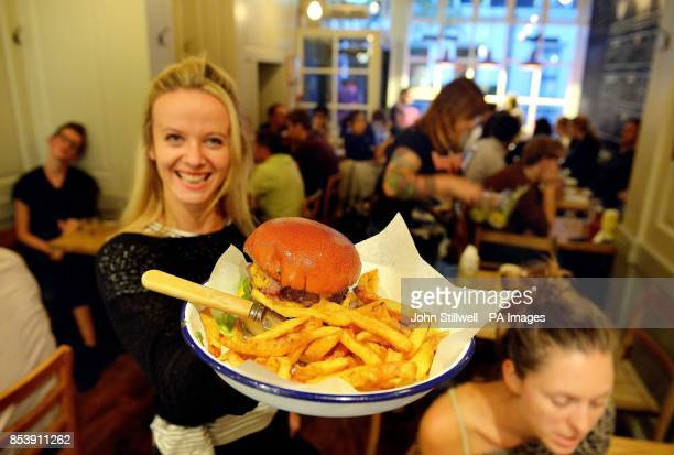 The Honest Burger Restaurant in Soho central London with its biggest and best selling burger The Tribute a traditional burger with bacon ahead of...