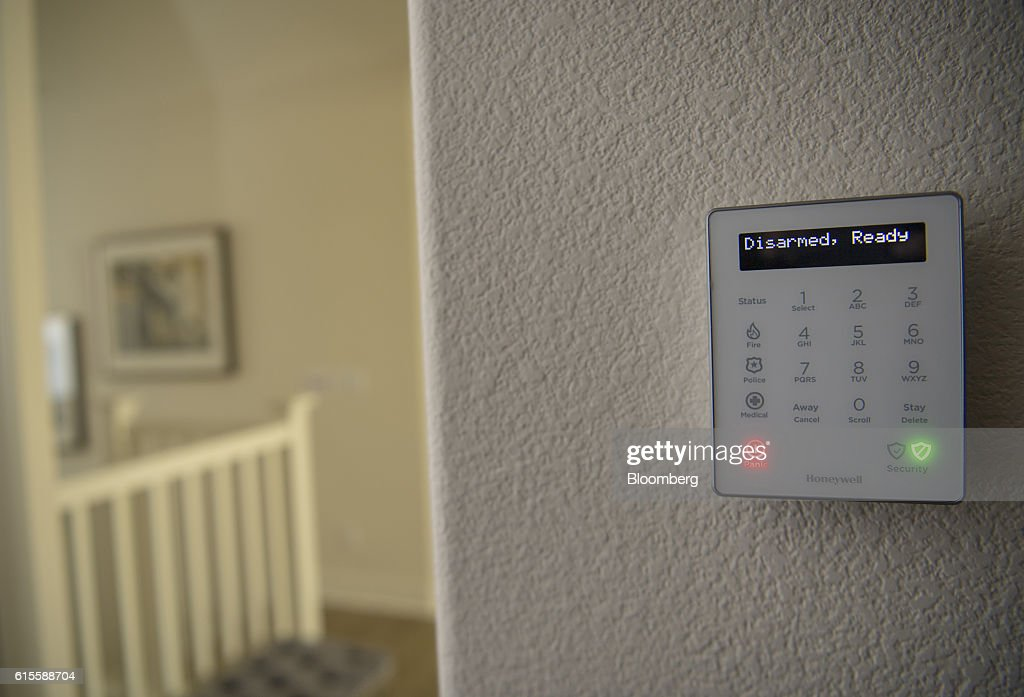 The Honeywell International Inc. Lyric Controller hangs on display inside a home at the Lennar Corp. Marina Shores development in Alameda, California, U.S., on Monday, Oct. 17, 2016. As iPhone sales growth slows, Apple Inc. is teaming up with a handful of builders to inch its way into the market for Internet-connected home furnishings, a nascent field that has attracted rivals like Alphabet Inc.s Google and Amazon.com. Photographer: David Paul Morris/Bloomberg via Getty Images