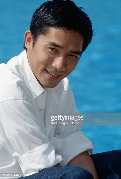 The Hong Kong actor Tony Leung star of films including Bullet in the Head and Cyclo sits by a pool in Venice Italy